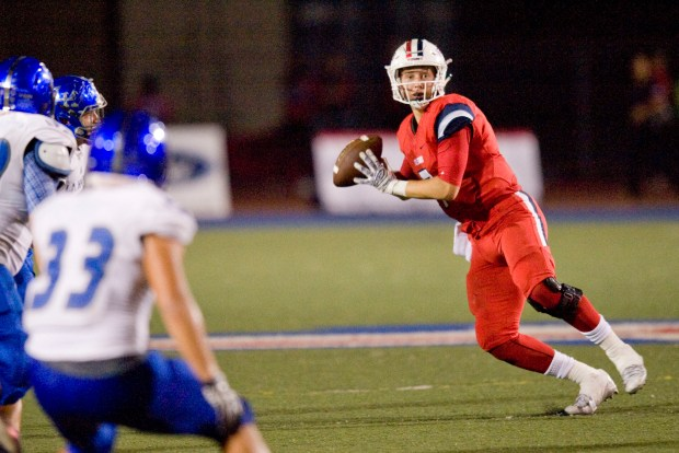 Tesoro quarterback Chase Petersen looks for a receiver in the second quarter against La Habra on Friday.(Photo by PAUL RODRIGUEZ )