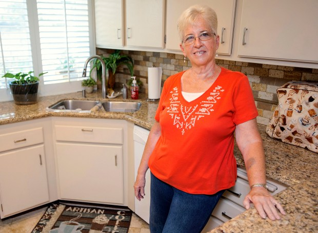 Regina Harper had a tough time finding a home - until she bid $25,000 over the asking price for one in Anaheim. (Photo by Ken Steinhardt, Orange County Register/SCNG)