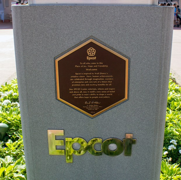 The dedication plaque for Epcot near the front entrance of the theme park at the Walt Disney World Resort in Florida. The plaque says: To all who come to this place of joy, hope and friendship, welcome. Epcot Center is inspired by Walt Disney's creative genius. Here, human achievements are celebrated through imagination, the wonders of enterprise, and concepts of a future that promises new and exciting benefits for all.May Epcot Center entertain, inform and inspire. And, above all, may it instill a new sense of belief and pride in man's ability to shape a world that offers hope to people everywhere. —E. Cardon Walker, October 24, 1982 Walker was the president of the Walt Disney Company at the time of the dedication. (Photo by Mark Eades, Orange County Register/SCNG)