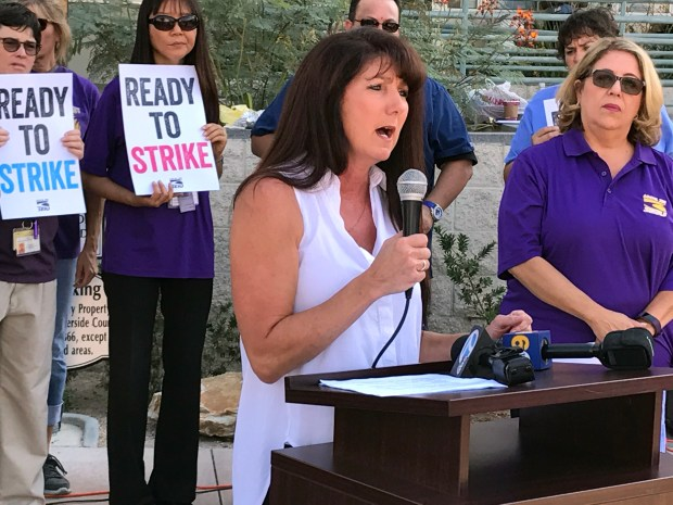 Teri Lopez, an emergency room nurse at Riverside University Health System - Medical Center in Moreno Valley, describes being assaulted by a patient at a Service Employees International Union Local 721 rally outside Riverside County headquarters in Riverside on Tuesday, Aug. 29. Photo by Jeff Horseman, The Press-Enterprise/SCNG