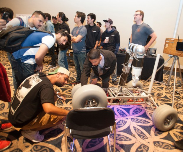 The Titan Rover draws a big crowd of observers at an engineering showcase at Cal State Fullerton in May. (Photo by Sam Gangwer, Orange County Register/SCNG