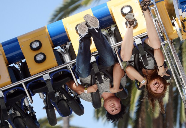 Jordan Ferman, 21 and Stephanie Martinez, 18, both from Fontana, react as they get inverted while riding OMG! on opening day of the L.A. County Fair at Fairplex in Pomona Friday September 2, 2016. The fair runs through September 25. (Will Lester/SCNG-INLAND VALLEY DAILY BULLETIN)