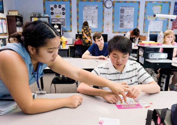 "A one-on-one aide, left, helps a student during a game ""Fractions Bingo"" in math class at New Vista School in Laguna Hills on Thursday, July 27, 2017. (Photo by Leonard Ortiz, Orange County Register/SCNG)"