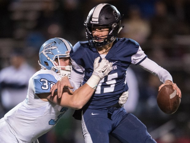 Corona del Mar high's Clyde Moore sacks Sierra Canyon high's quarterback Johnny Hawkins during the second half of the CIF-SS Division 4 championship game at Granada Hills High in Granada Hills on Friday, December 02, 2016. Sierra Canyon high wins in double overtime with the score of 36 to 35. (Photo by Ed Crisostomo, Orange County Register/SCNG)