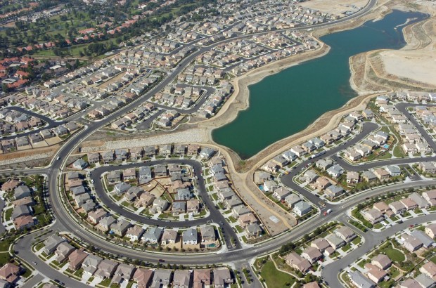 In this 2006 file photo, houses and the flood control basin at the Colonies Crossroads development in Upland are seen from the air. (File Photo)