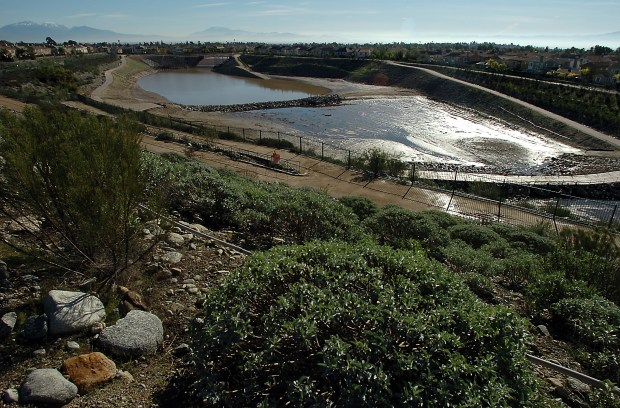 In this 2010 file photo, the flood control basin at the Colonies Crossroads development in Upland is seen. (File Photo)