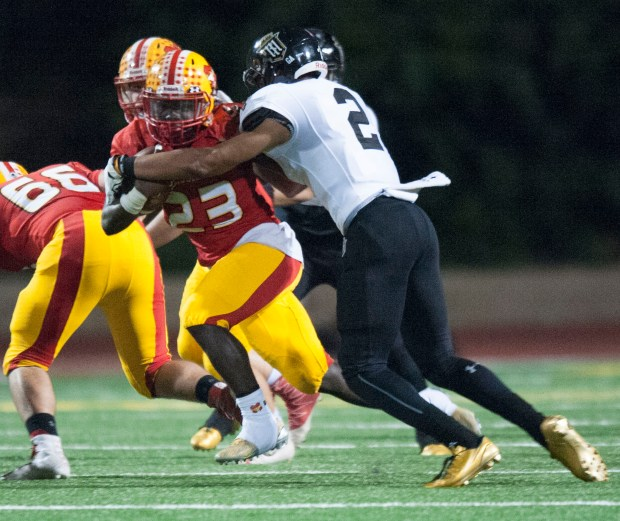 Mission Viejo's Jamari Ferrell tries to shake off Servite's Julius Irvin in the first round of the CIF-SS Division 1 playoffs in Mission Viejo on Friday, November 11, 2016. (Photo by Matt Masin, Orange County Register, SCNG)