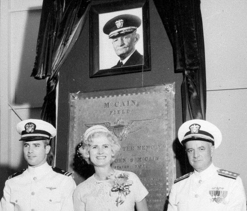 In this July 14, 1961, file photo, then Lt. John S. McCain III, left, and his parents, Rear Adm. John S. McCain Jr. and Roberta Wright McCain take part in the ceremony to commission McCain Field, the U.S. Navy training base in Meridian, Miss., named in honor of Adm. John S. McCain, in photo at top, respectively grandfather and father to the two McCains. Ten U.S. sailors are missing after a collision between the USS John S. McCain and a tanker early Monday, Aug. 21, 2017, east of Singapore, the second accident involving a ship from the Navy's 7th Fleet in the Pacific in two months. The 154-meter (505-foot) McCain is named after U.S. Sen. John McCain's father and grandfather, who were both U.S. admirals. (AP Photo/File)