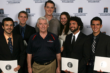 Physics alum and donor Dan Black, center, stands with 2013 Dan Black scholarship awardees, including Phillipe Diego Rodriguez, far right. (Photo courtesy of Greg Andersen)