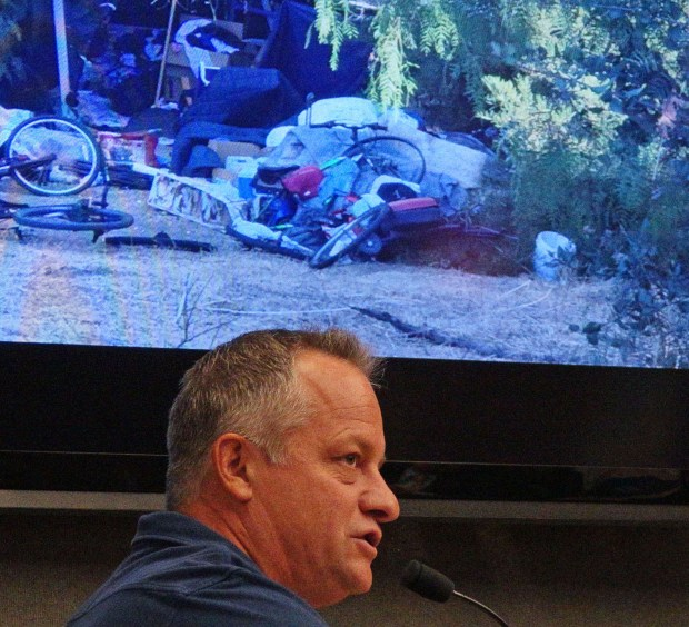 Anthony LaFrano, a San Clemente resident, displayed photos of homeless encampments off Avenida Pico at a Sept. 5 City Council meeting. He appealed to the council to clean them up. (Fred Swegles, Orange County Register/SCNG)