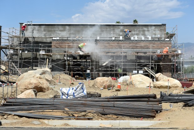 Construction crews contine to work on the new Redlands Packing House District shopping center on Eureka St., with Sprouts Farmers Market set to open Sept. 20., Sprouts officials announced in a news release. (Photo by John Valenzuela/Redlands Daily Facts/SCNG)