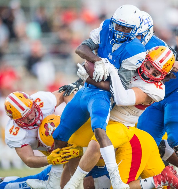 La Habra's Skyler Taylor is tackled by Mission Viejo's Shaun Adamson during a game at La Habra high school in La Habra on Friday, September 8, 2017. (Photo by Matt Masin, Orange County Register, SCNG)