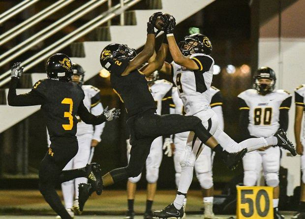 In a play that saw two players ejected and then restored, Godinez' Eddie Bravo, right, takes the ball away from Sunny Hills defender, Railan Peace, left, during the first half of their Friday night game.(Photo by Michael Kitada, Contributing Photographer)