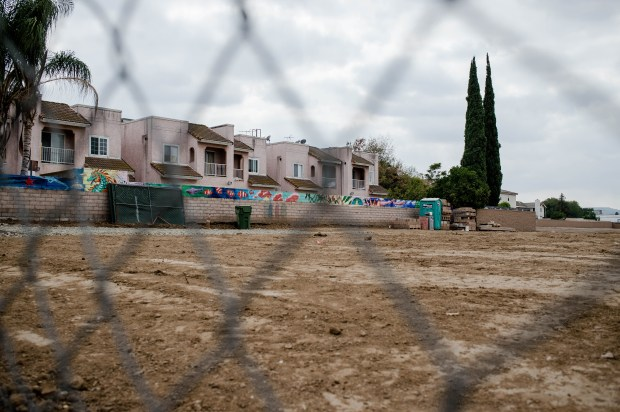 A lot between homes and De Valle Elementary School, seen on Tuesday, Sept. 19, 2017, is where Brandywine Homes' infill project, a gated community of 45 single-family homes, is being built in La Puente. (Photo by Sarah Reingewirtz, Pasadena Star-News/SCNG)
