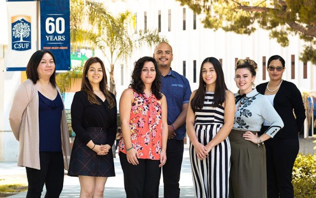 The new CSU Pre-Doctoral Scholars at Cal State Fullerton are, from left: Mercy Tran, Stacy Guzman, Bahar Tahamtani, José Zamora, Elizabeth Mercado Ayon, Michelle Cadwell and Araceli Robles. (Photo courtesy of Cal State Fullerton)