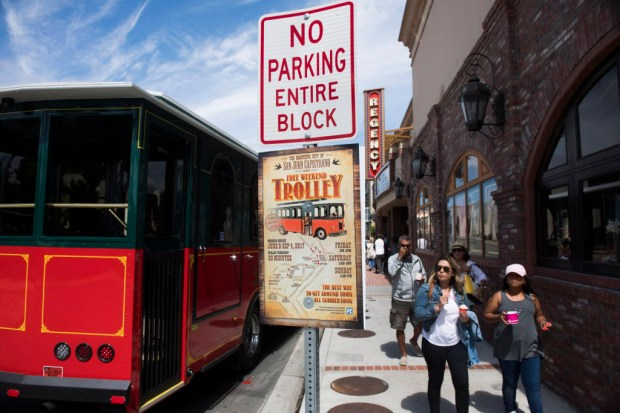 Ice-cream eating visitors stroll the sidewalk along San Juan Capistrano's Verdugo Street, where the city is proposing pedestrian-friendly upgrades. (File photo by Kevin Sullivan, Orange County Register/SCNG)