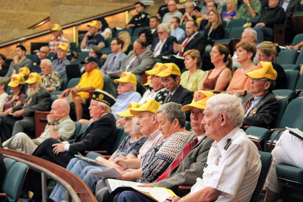 Veterans and others wearing a yellow cap to show support for a military veterans cemetery in Orange County listen to the Irvine City Council discuss the issue Sept. 26, 2017. (Tomoya Shimura, Orange County Register/SCNG)