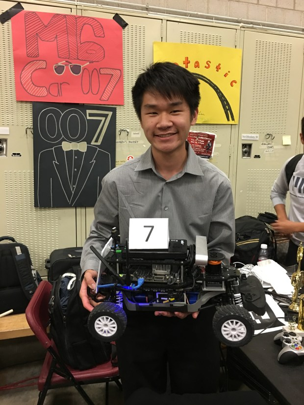 Matthew Tang, a senior at Northwood High School, poses for a photo with a self-driving car he built with his teammates at the 2017 MIT Beaver Works Summer Institute. (Courtesy of Matthew Tang)