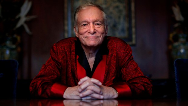 In this Nov. 4, 2010, file photo, Playboy magazine founder Hugh Hefner poses for photos at the Playboy Mansion in Los Angeles. The Playboy magazine founder and sexual revolution symbol Hefner died at age 91. (AP Photo/Jae C. Hong, File)