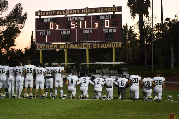 A group of Notre Dame players take a knee during the national anthem before their game against Alemany, September 29, 2017, at Alemany. (Photo by Michael Owen Baker)