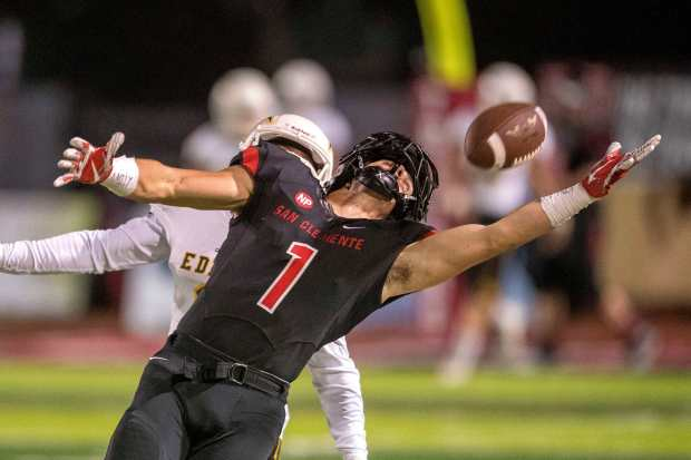 San Clemente's Jack Shippy beats an Edison defender and almost pulls in a pass in the first quarter in San Clemente on Friday, September 29, 2017. (Photo by Paul Rodriguez, Orange County Register/SCNG)