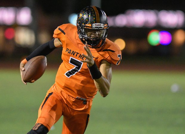 Orange's Jason Wilkinson rounds the corner for extra yards in the first half of his team's game against Godinez during their game at Fred Kelly Stadium in Orange, CA on Friday September 29, 2017. (Photo by Michael Kitada, Contributing Photographer)
