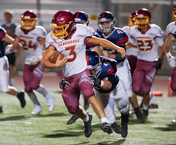 El Modena running back Andrew Carvajal is brought down by Yorba Linda linebacker Jacob Cochran in a non-league varsity football game at Yorba Linda High Friday night. Friday, September 29, 2017. (Photo by Sam Gangwer, Orange County Register/SCNG)