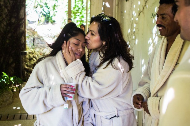 Southern California Hospice Foundation granted the final wish of cancer patient Judith Hernandez, left, to spend the day at a spa with her mother, center, boyfriend and family. (Photo by Watchara Phomicinda, The Press-Enterprise/SCNG)
