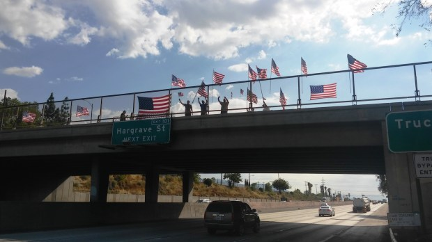 Representatives of the Fire Memories Museum display flags on the San Gorgonio Avenue overpass above the 10 Freeway in Banning to commemorate the Sept. 11 attacks on Monday, Sept. 11.Photo by Craig Shultz, staff