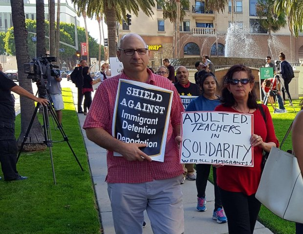 Teachers, students and immigrant rights activists marched Tuesday, Sept. 12, 2017, in support of DACA participants.