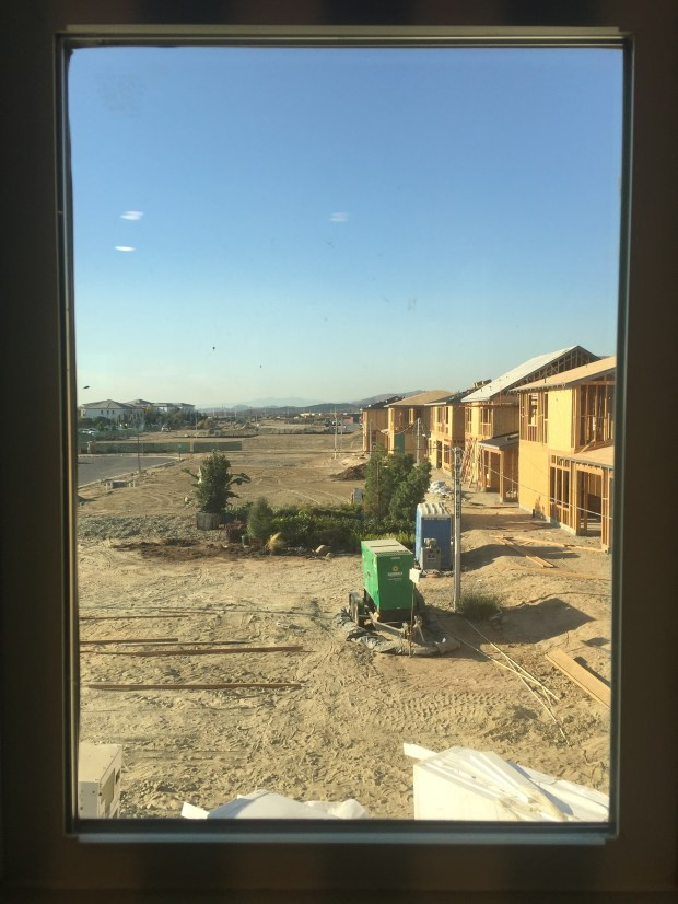A view from a model home window shows Altair Irvine's ongoing construction. The gated community will eventually feature 840 homes near the Orange County Great Park. (Tomoya Shimura, Orange County Register/SCNG)