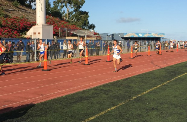 Dana Hills' Jack Landgraf heads toward the finish line in the Division 1 boys race of the Dana Hills Invitational. Landgraf won the race for a record third consecutive year. (Photo by Zach Cavanagh, Contributor)