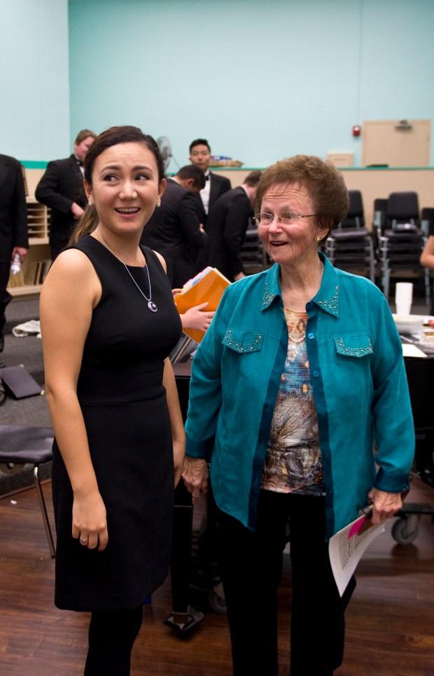 Marian Mine, left, teaches choir at Brethren Christian High School. (Photo by Matt Masin, Orange County Register)