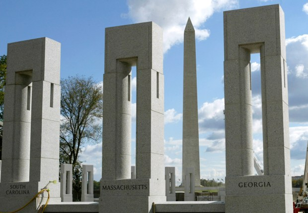 A view of the Washington Monument through the pillars of the National World War II Memorial, shown in this Oct. 22, 2003, file photo in Washington. (AP Photo/Evan Vucci/file)
