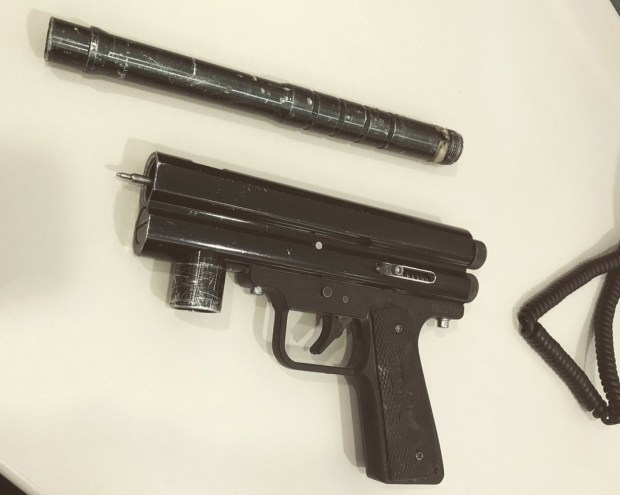"Police recovered this paintball gun, which two suspects allegedly loaded with birdshot and fired at a homeless man they were charging ""rent"" to live at a public park in North Hollywood. (Photo courtesy of the LAPD)"