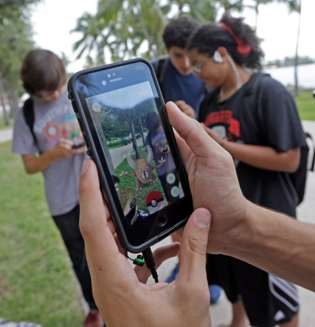 While millions of young people eagerly play games such as Pokemon Go ontheir phones, not all have mastered complex classwork on the smaller screens. (AP Photo/Alan Diaz, File)
