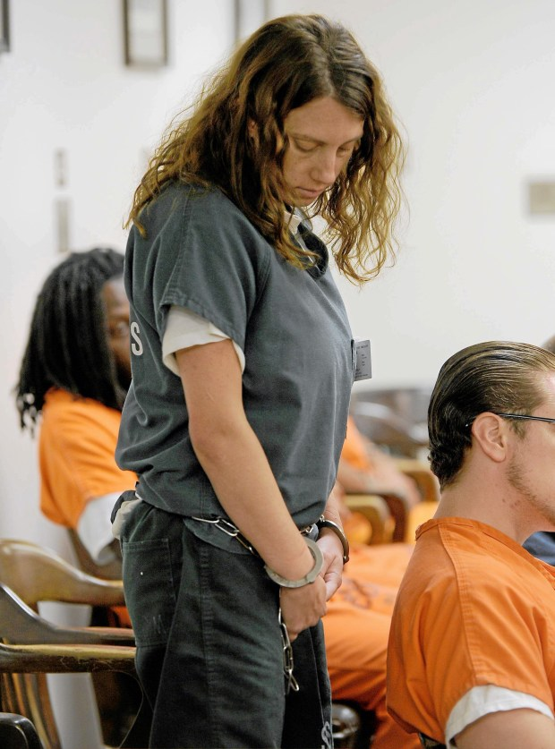 San Bernardino County sheriff's deputies escort Laura Whitehurst into a courtroom on July 1, 2013. (Staff file photo by LaFonzo Carter, Redlands Daily Facts/SCNG)