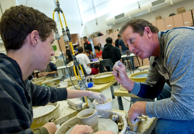 Rob Stuart, right, teaches ceramics at Northwood High School. (Photo by Paul Bersebach, Orange County Register/SCNG)