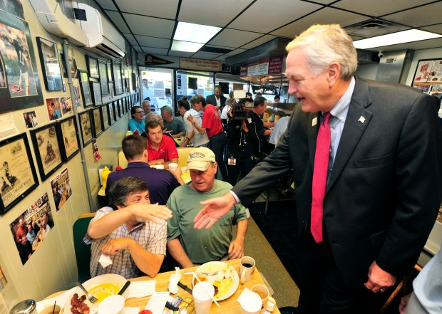 Republican Sen. Luther Strange shakes hands with Jackson Como and David Hodges while they eat breakfast at Salem's Diner Tuesday, Sept. 26, 2017, in Birmingham, Ala. Voters will choose between former state Supreme Court Chief Justice Roy Moore and Strange in a race that brought President Trump and other political heavyweights to Alabama. (AP Photo/Eric Schultz)