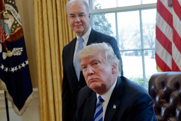 In this March 24, 2017 file photo, President Donald Trump with Health and Human Services Secretary Tom Price are seen in the Oval Office of the White House in Washington. Price resigned Sept. 29, after his costly travel triggered investigations that overshadowed the administration's agenda and angered his boss. Price's regrets and partial repayment couldn't save his job. (AP Photo/Pablo Martinez Monsivais, File)