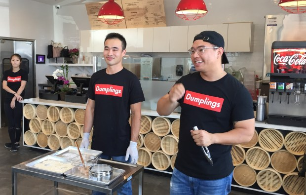 Allan Tea, owner of Paper Lantern Dumpling House at the Diamond Jamboree Center in Irvine, right, introduces his chef Ken Cao, left, during a media tasting event Sept. 28, 2017. (Tomoya Shimura, Orange County Register/SCNG)