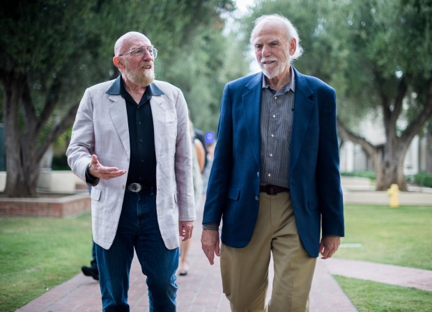 Caltech professors Kip Thorne, left, and Barry Barish walk through Caltech in Pasadena after being awarded the Nobel Prize in Physics on Tuesday, Oct. 3, 2017 for the development and success of LIGO's observation of gravitational waves predicted by Albert Einstein. The prize is shared with MIT's professor Rainer Weiss. (Photo by Sarah Reingewirtz, Pasadena Star-News/SCNG)