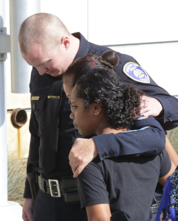Manhattan Beach Police Officer Chad Swanson, who sustained non-life-threatening injuries in the Las Vegas mass shooting, comforts MBPD intern Sayeh Khan and Police Chief Eve Irvine at a news conference Tuesday, Oct 3, 2017. (Photo by Chuck Bennett, Daily Breeze/SCNG)