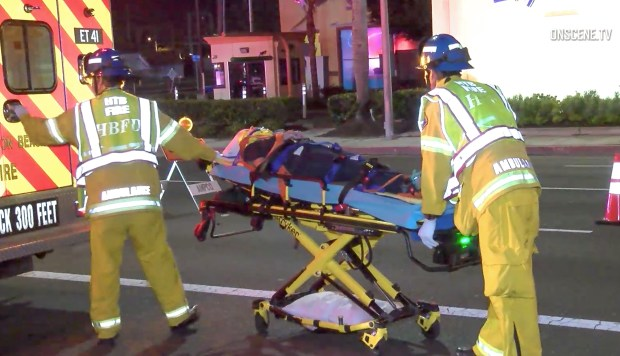 Huntington Beach firefighters roll an injured person to an ambulance after a two car collision early Thursday, October 5, 2017. (Photo by Onscene.TV)