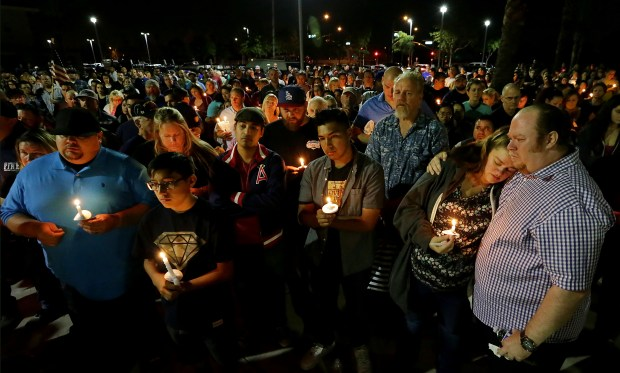 Family and friends mourn the loss of Las Vegas shooting victim Rocio Rocha Guillen, 40, during candlelight vigil at Roosevelt High School Thursday in Eastvale on October 5, 2017. (Photo by Terry Pierson, The Press-Enterprise/SCNG)