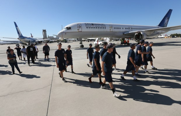 Teams consisting of San Bernardino County Fire Department hand crew and members of the San Bernardino city police and county sheriffs departments participating in the SB Strong Plane Pull leave after a practice session on Thursday, Oct. 5, 2017 at the San Bernardino International Airport. The plane pull, which benefits the Loma Linda University Children's Hospital, will be held on day 2 of SBD Fest.(Stan Lim, San Bernardino Sun/SCNG)