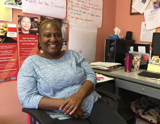 "Sandra Johnson, at her office in San Francisco, urges that people not be ""held hostage by our mistakes."" Photo by Lee Romney for CALmatters"