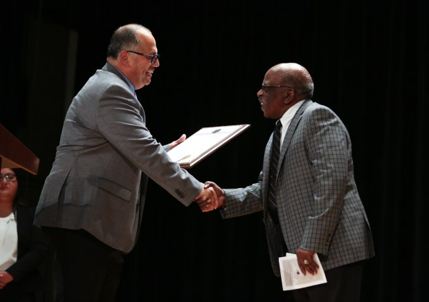 Vice Mayor Leonard Shryock shakes hands with Lee Mitchell during the plaque dedication ceremony. The Norwalk-La Mirada Unified School District dedicates a plaque to Lee Mitchell, a retired band director and the first African-American teacher in the district on Saturday, Oct. 14, 2017. (Photo by Shilah Montiel for SCNG)