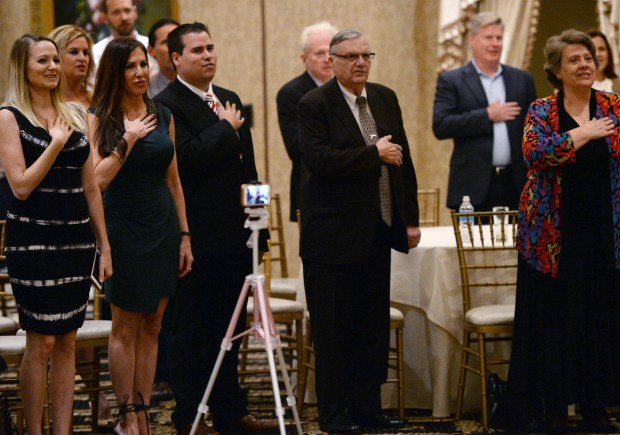 Ex Maricopa County Sheriff Joe Arpaio,right, during the Pledge of Allegiance, at a campaign event at Trump National Golf Club in Rancho Palos Verdes, for Omar Navarro, left, a South Bay Republican challenger to incumbent Rep. Maxine Waters. Rancho Palos Verdes Calif., Thursday, October 18, 2017. ( Photo by Stephen Carr / Daily Breeze / SCNG )