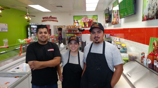 Rodrigo Lopez (left) and wife and husband Monica and Ernesto Lopez are part of the management team at Nicho's ice cream parlor in downtown Redlands. (Tabetha Wittenmyer/Correspondent)